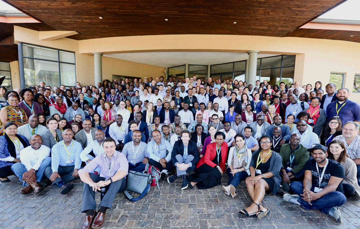 Attendees to the PEPFAR Data and Systems Applied Learning Summit pose for a photo together