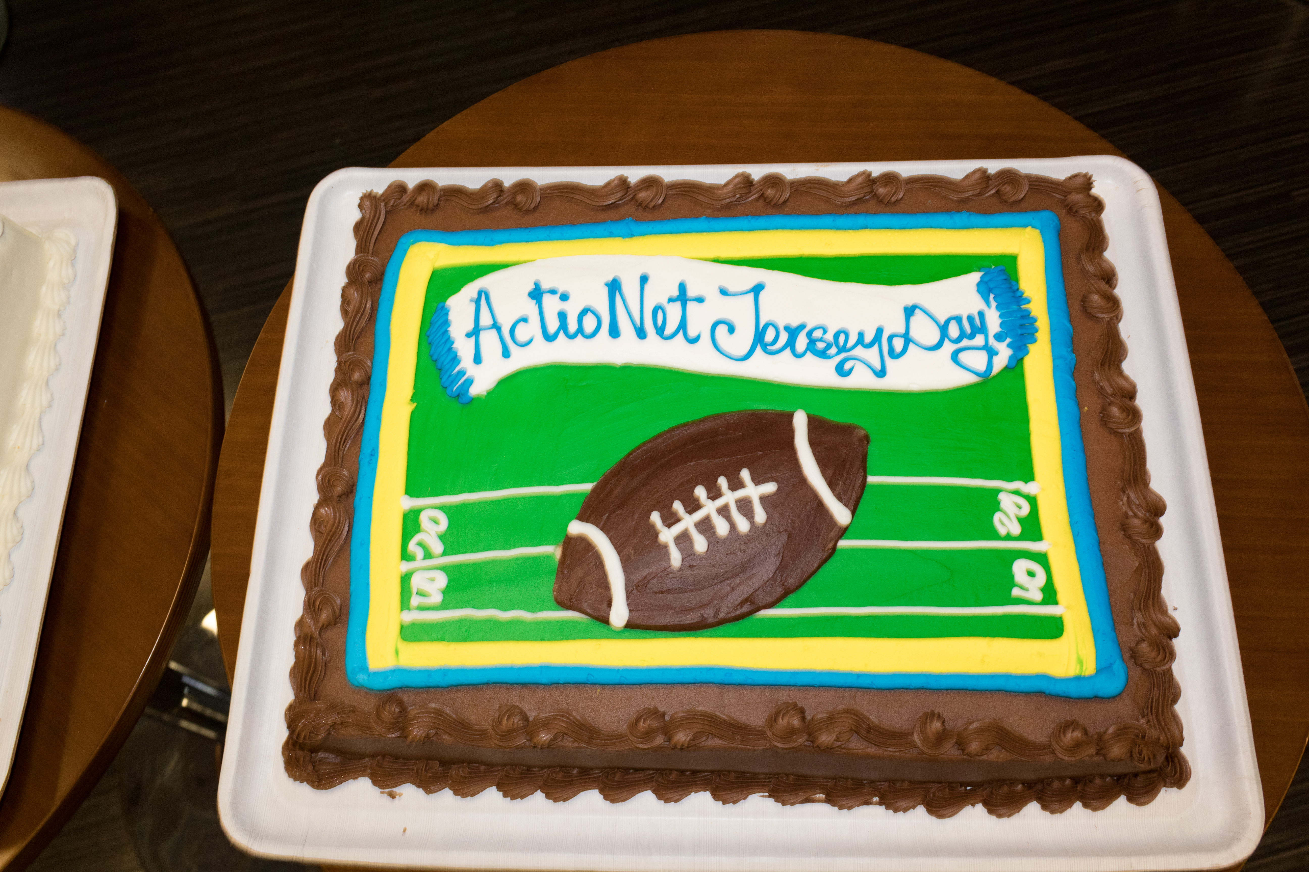 Football themed cake for the themed event