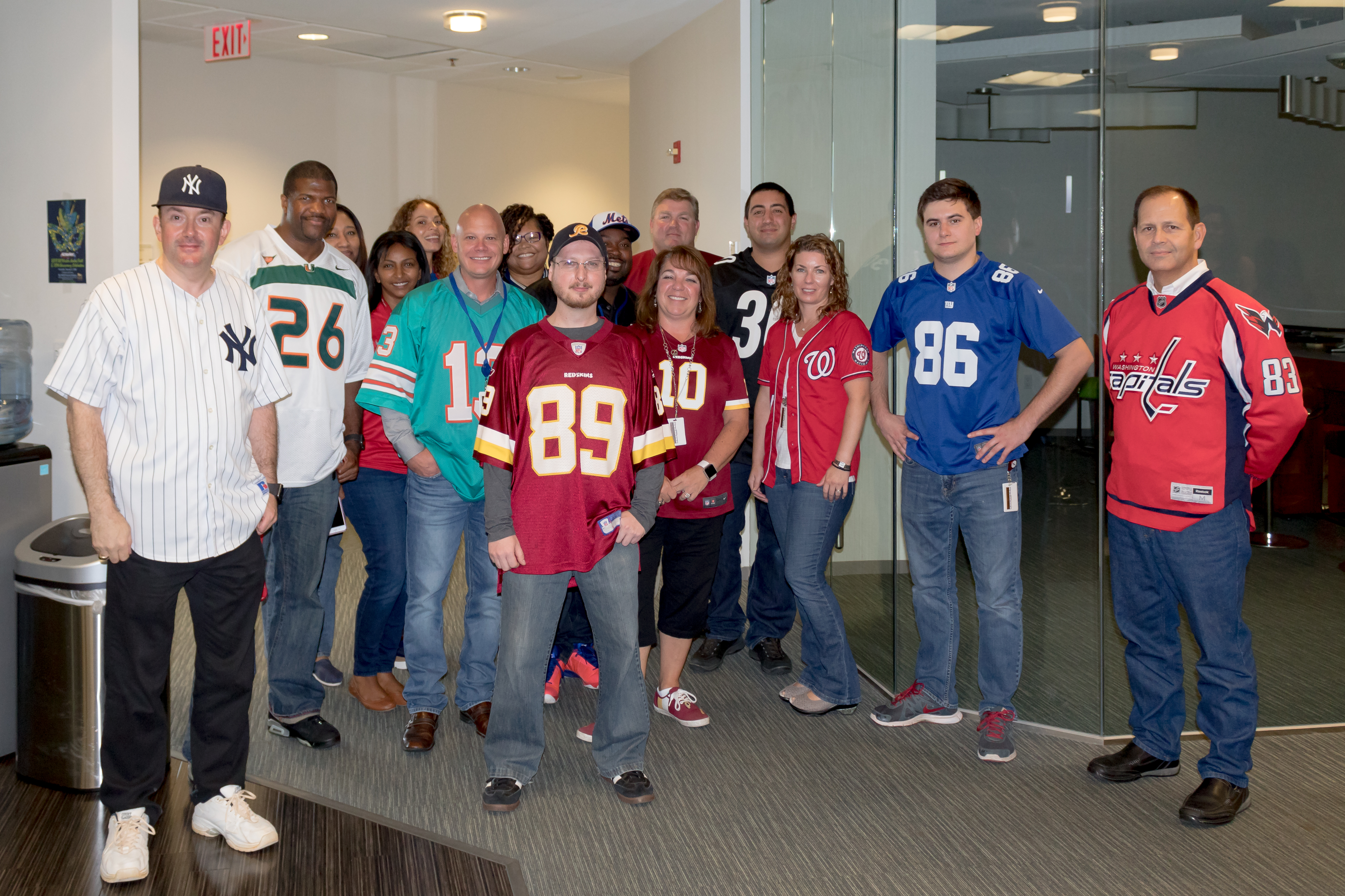 ActioNeters participating in Wear Your Favorite Team Jersey Day gather together despite wearing a variety of jerseys