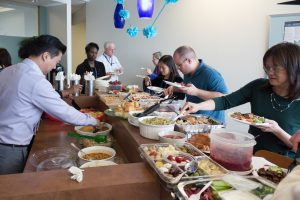 ActioNeters Share and Enjoy Food at the ActioNet Thanksgiving Potluck