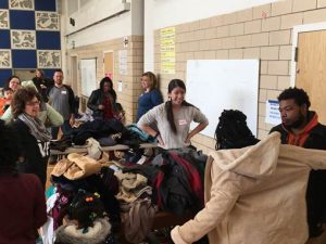 ActioNeters giving Coats to Charity