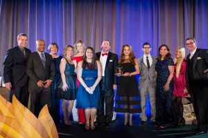 The Human Resources and Talent Acquisition team poses after receiving the ActioNet Service Organization Award