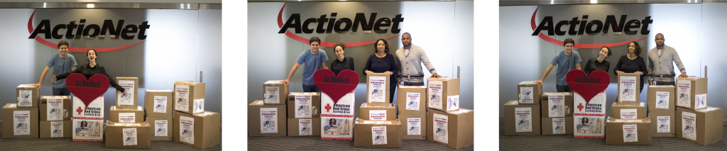 ActioNet employees display clothing donations to American Red Cross