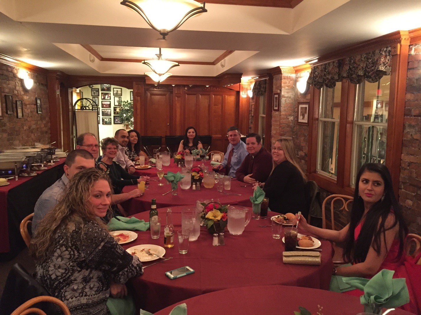 ActioNet employees together enjoying holiday dinner