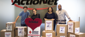 ActioNeters Pose with American Red Cross Clothing Donations