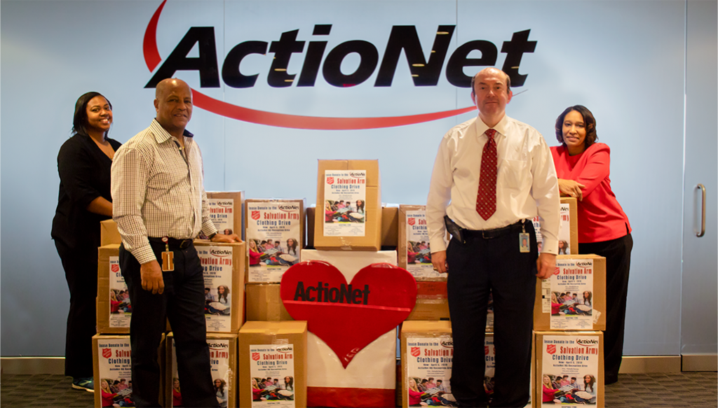 ActioNeters Stand with Donations for the Salvation Army