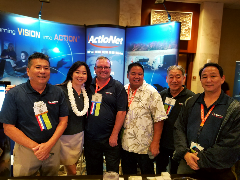 ActioNeters Pose in Front of the ActioNet Booth at TechNet Indo-Pacific