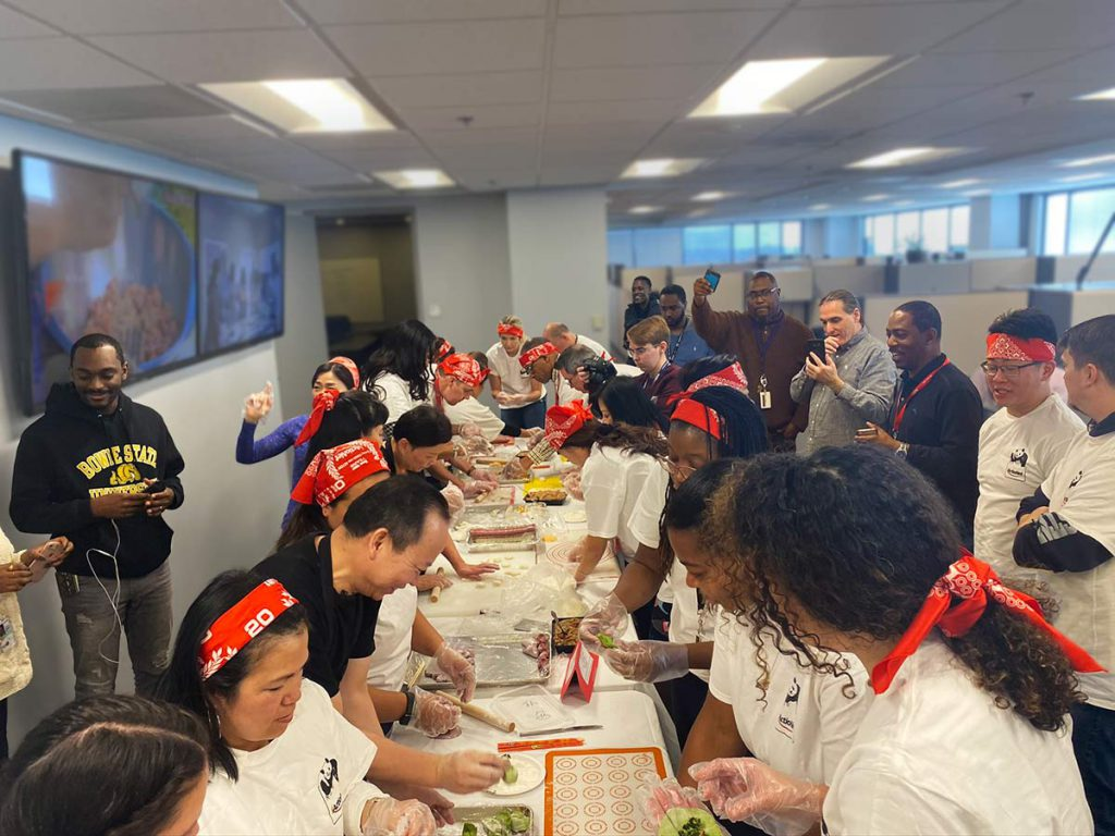 Dozens of ActioNeters volunteered to make additional dumplings with Peter Chang while a crowd watched
