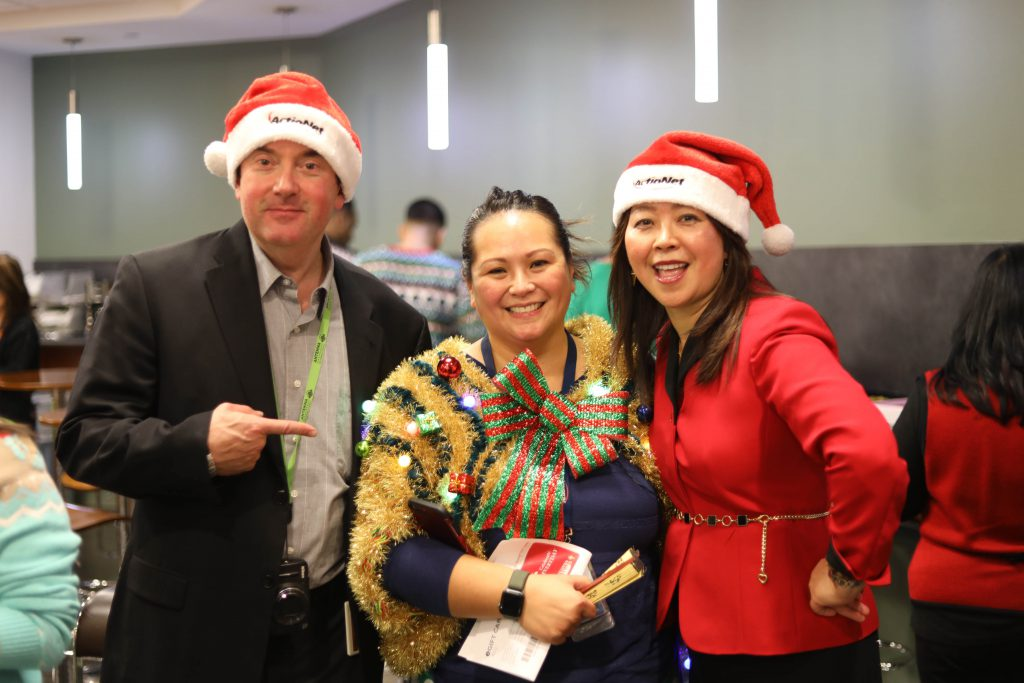 Ugly Sweater Winner Maricar shows off her Ugly Sweater with CEO Ashley and VP Jeff