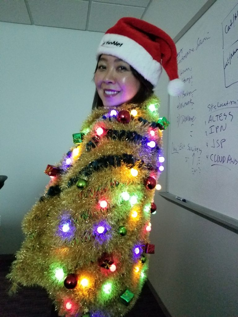 CEO Ashley Trying on the Winning Ugly Sweater