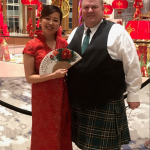 ActioNeter Brandon S. and CEO Ashley C. in their cultural gear for the 2020 winter party