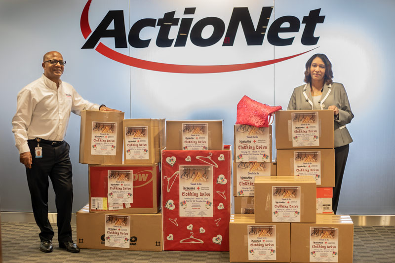 ActioNeters Michelle and Mengie boxed up clothing donations for the American Red Cross