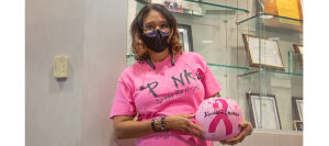Michelle with her pink pumpkin for breast cancer awareness