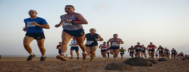 Runners participating in a race in the desert